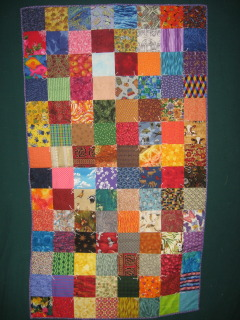 Charm quilt for a wheelchair